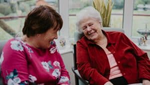 24 hour care worker with client