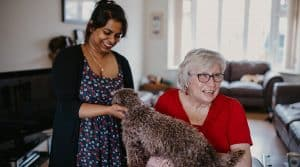 Live in care worker and client with dog