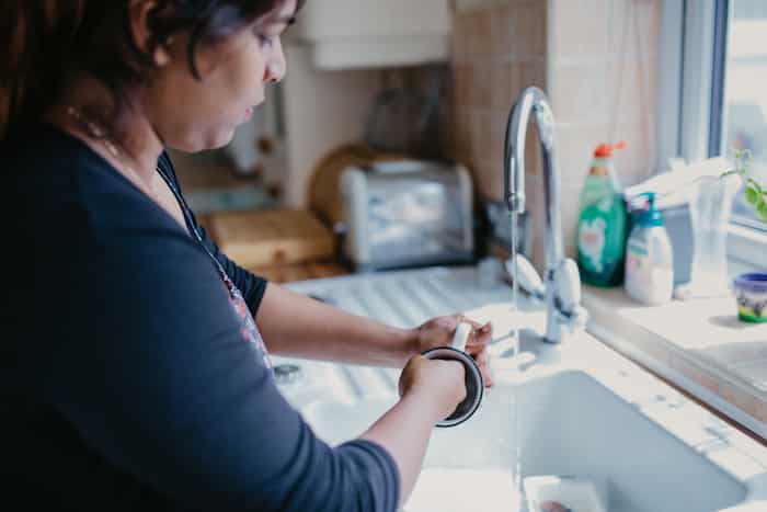 Live in care worker washing up