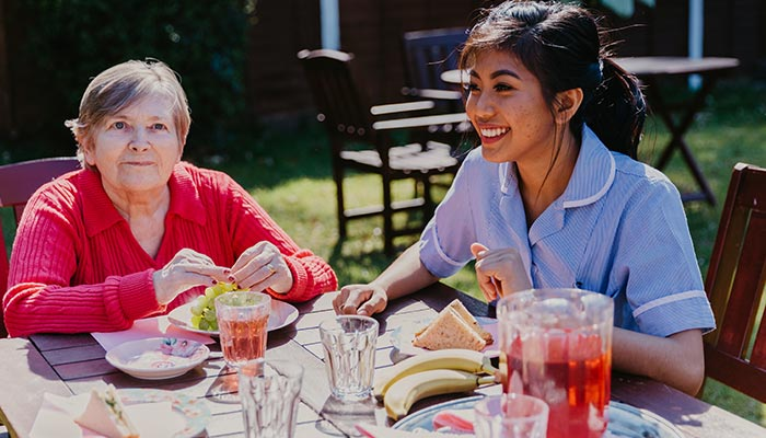 Tilford Care Home - client and care worker in garden
