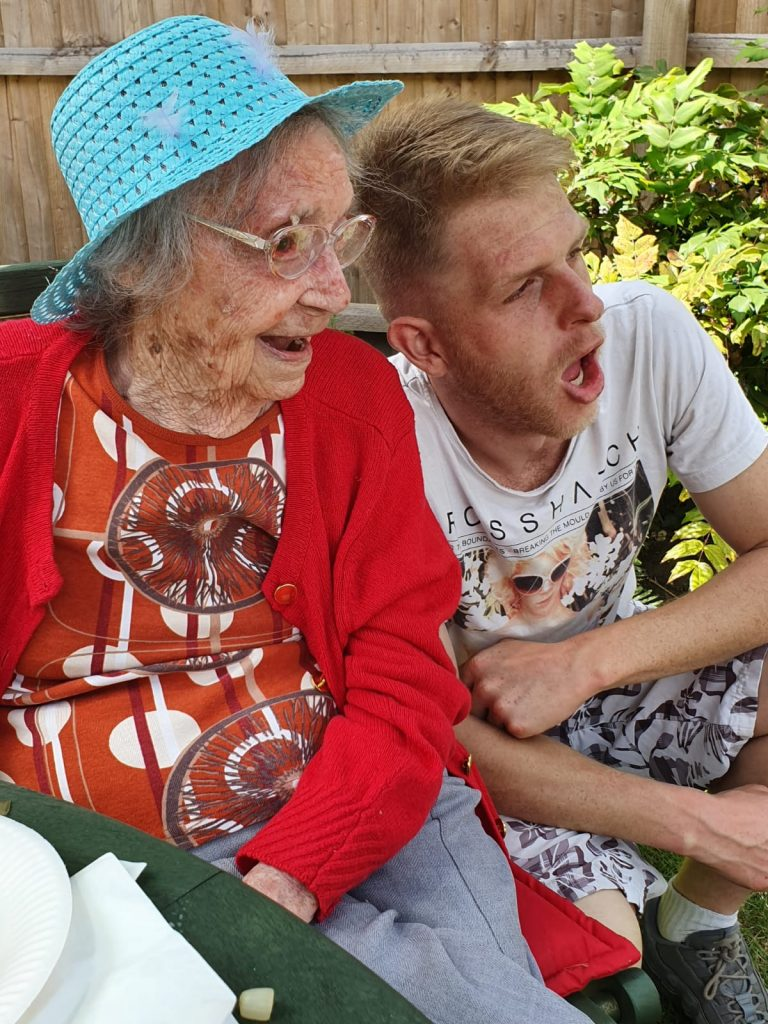 A Naseby Care Home resident enjoys a Punch and Judy show on Care Home Open Day 2019