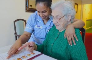 Care assistant jobs - helping client choose from menu