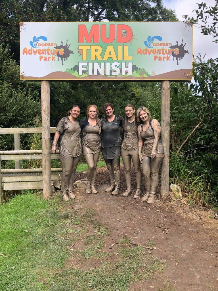 Four women finishing the Mud Trail