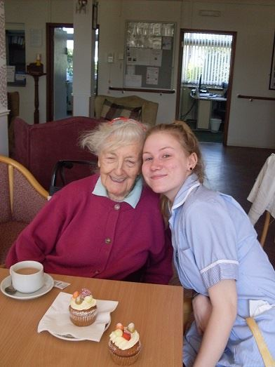 Lady and care worker at a coffee morning