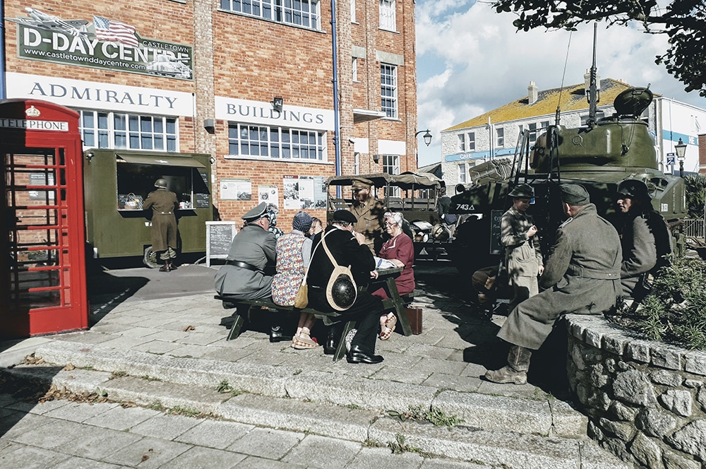 WW2 re-enactors sitting outside the D-Day Centre