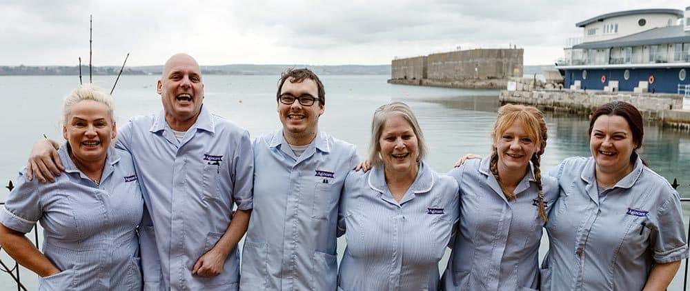 Care staff in front of Portland Harbour