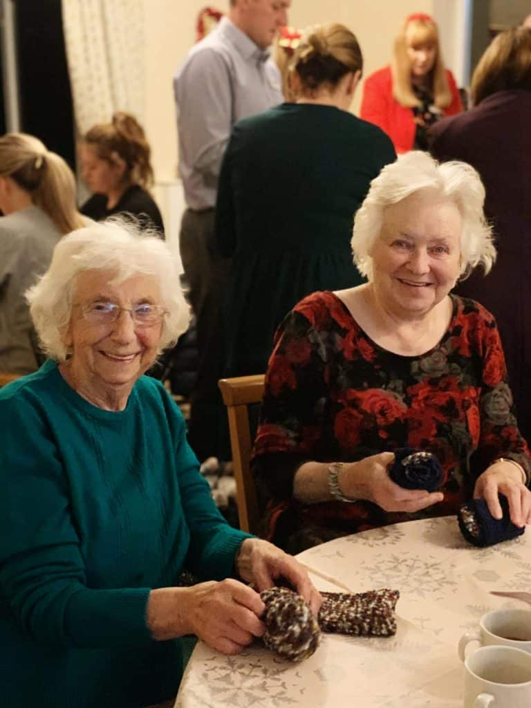 Two Cheriton Care Centre residents stuffing Christmas socks
