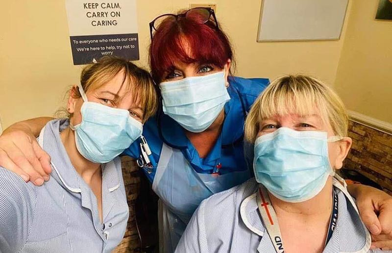 Care workers wearing PPE face masks