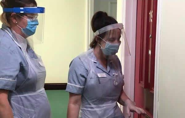 Care home staff with PPE visors