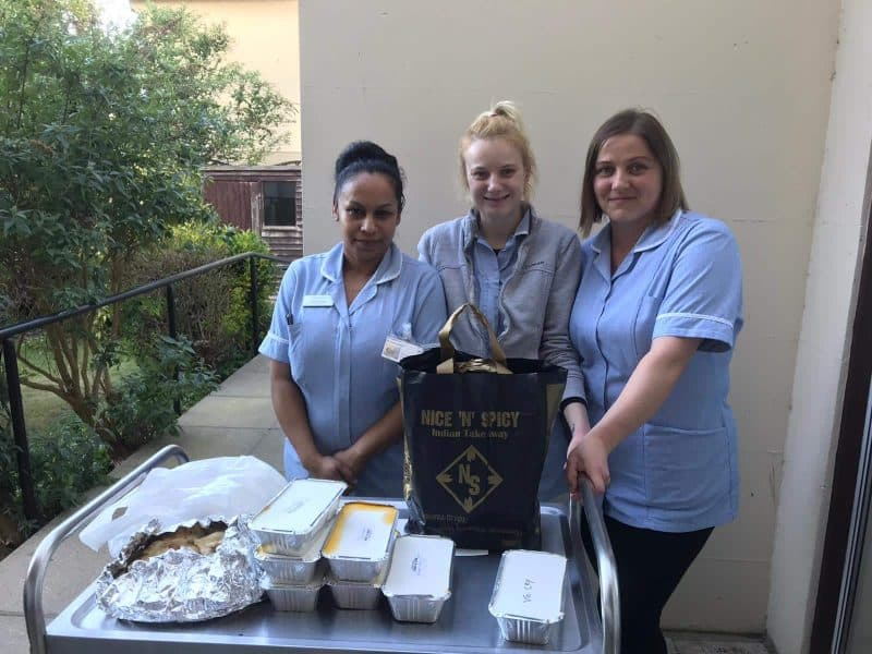 Three care workers with free curry