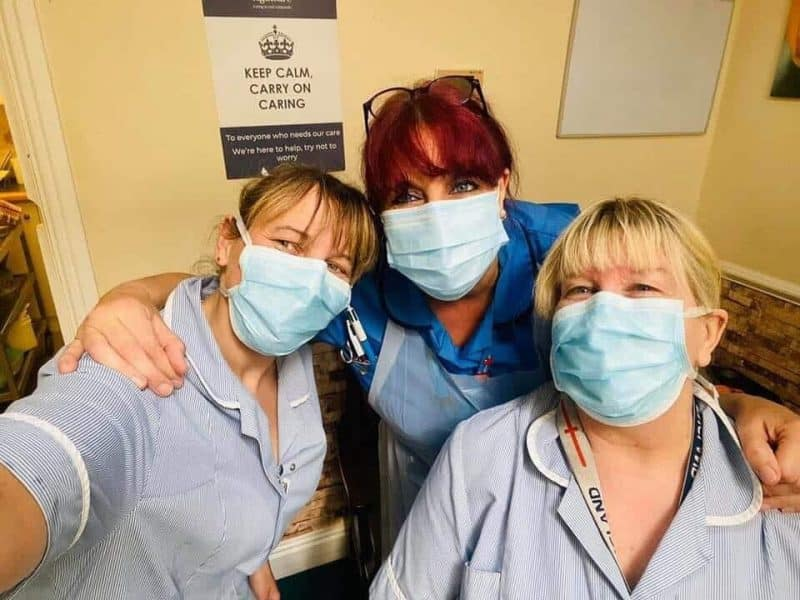 Three healthcare workers wearing face masks