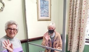 care home visit with perspex screen