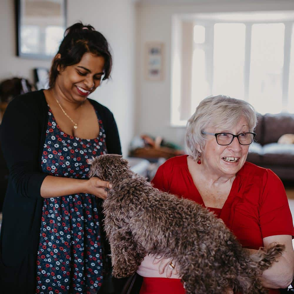 Live-in care worker with client