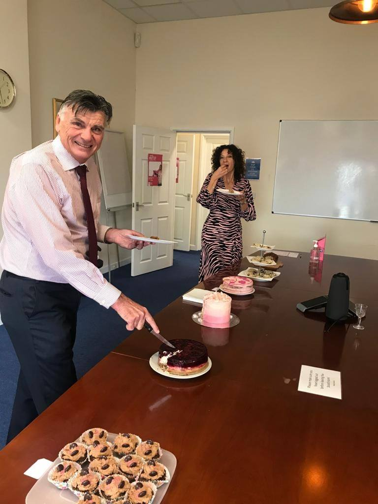 Agincare's Chairman Derek Luckhurst and CEO Raina Summerson judge charity bake-off