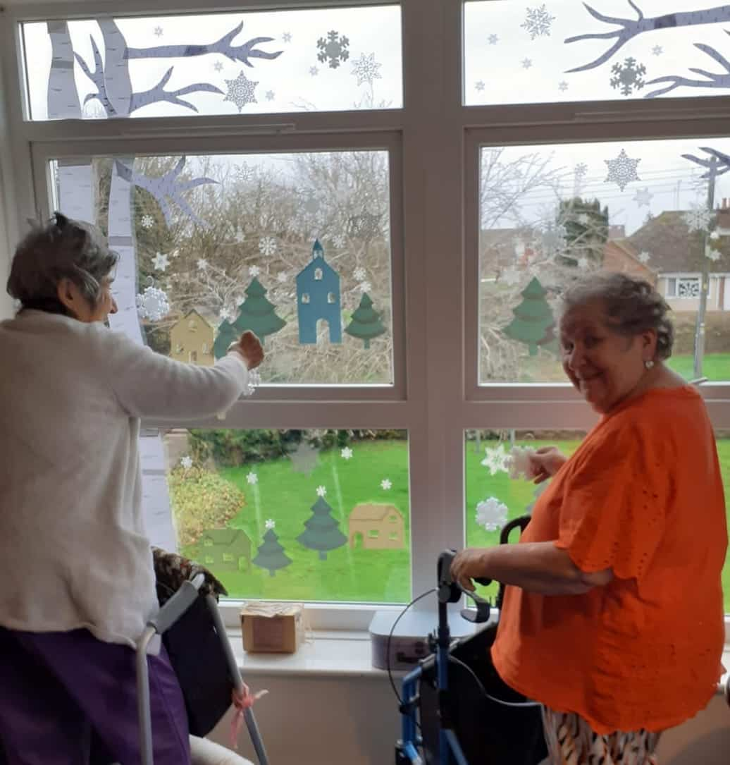 Decorating the Advent window at Lansdowne Care Home in Swindon