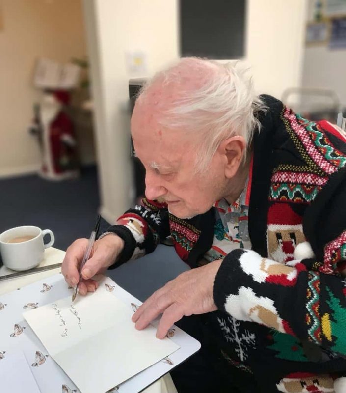 Jim writes Christmas cards at Edgehill Care Home in Swindon