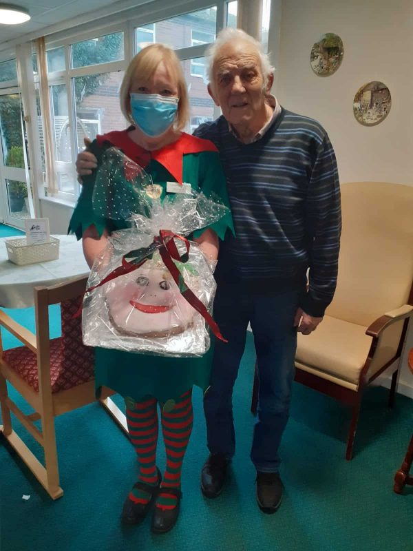 Bob wins the giant elf cookie at Lansdowne Hill Care Home in Swindon