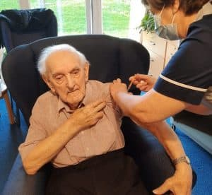 Image of care home resident vaccinated