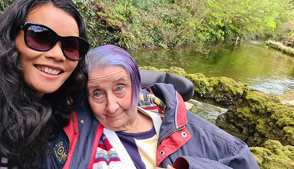 Live-in care gardening - Tracey and carer